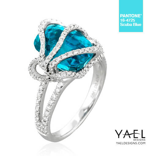 18k white gold ring featuring 9.32 carat blue zircon, accented with 0.42 carats of ideal cut diamonds